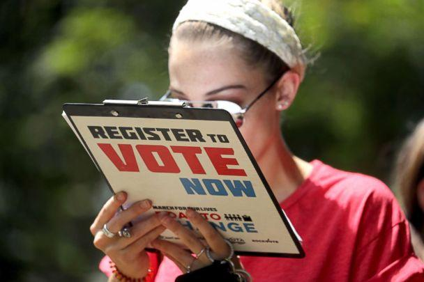 PHOTO: Chloe Weiland registers to vote during the Road to Change bus tour, July 28, 2018, in Tallahassee, Fla. (Mike Stocker/South Florida Sun-Sentinel via AP)
