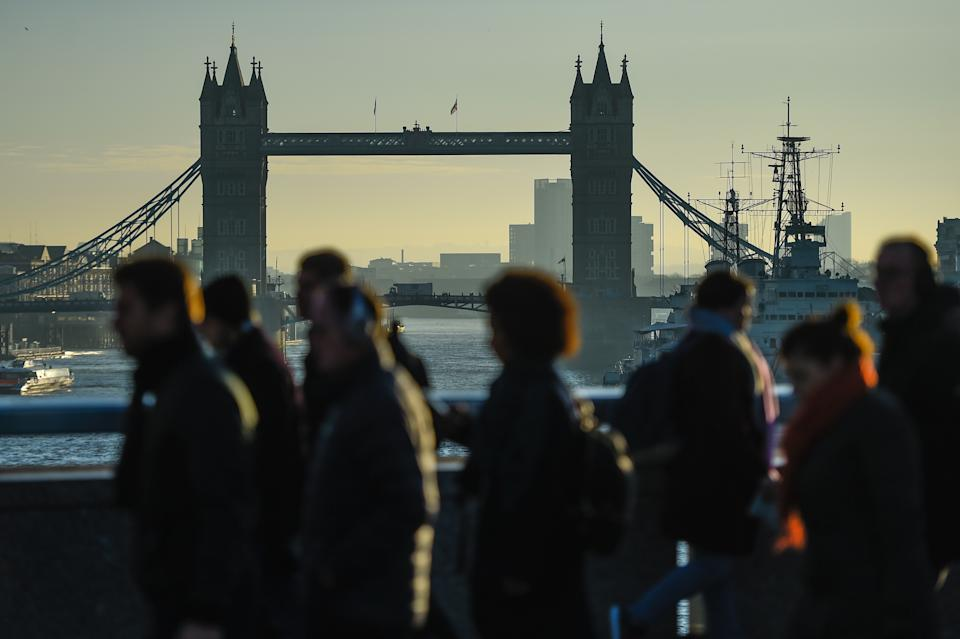 LONDON, ENGLAND - DECEMBER 02: Commuters cross London Bridge, after it was reopened following last weeks terror attack, on December 2, 2019 in London, England. Usman Khan, a 28 year old former prisoner convicted of terrorism offences, killed two people in Fishmongers' Hall at the North end of London Bridge on Friday, November 29, before continuing his attack on the bridge. Mr Khan was restrained and disarmed by members of the public before being shot by armed police. (Photo by Peter Summers/Getty Images)