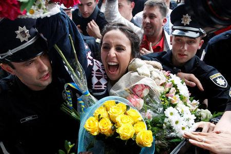 FILE PHOTO: Crimean Tatar singer Susana Jamaladinova, known as Jamala, who won the Eurovision Song Contest, reacts during a welcoming ceremony upon her arrival at Boryspil International Airport outside Kiev, Ukraine, May 15, 2016. REUTERS/Roman Baluk/File Photo