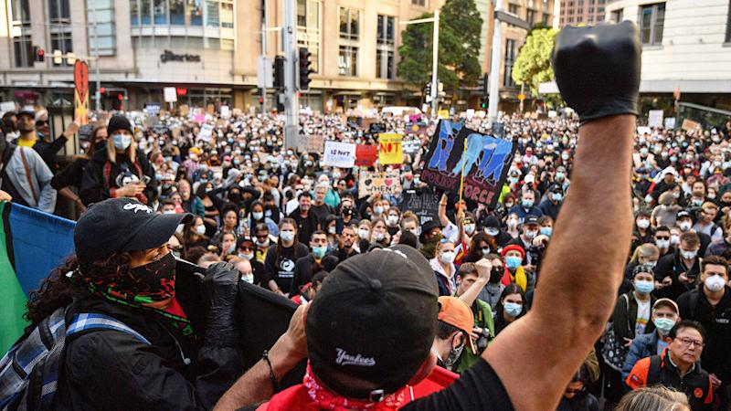 Pictured here, speakers address the Sydney crowd during Saturday's protest.