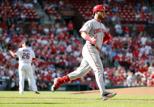 Cincinnati Reds' Eugenio Suarez, right, rounds the bases after hitting a two-run home run off St. Louis Cardinals relief pitcher Bud Norris (26) during the tenth inning of a baseball game Sunday, Sept. 2, 2018, in St. Louis. (AP Photo/Jeff Roberson)