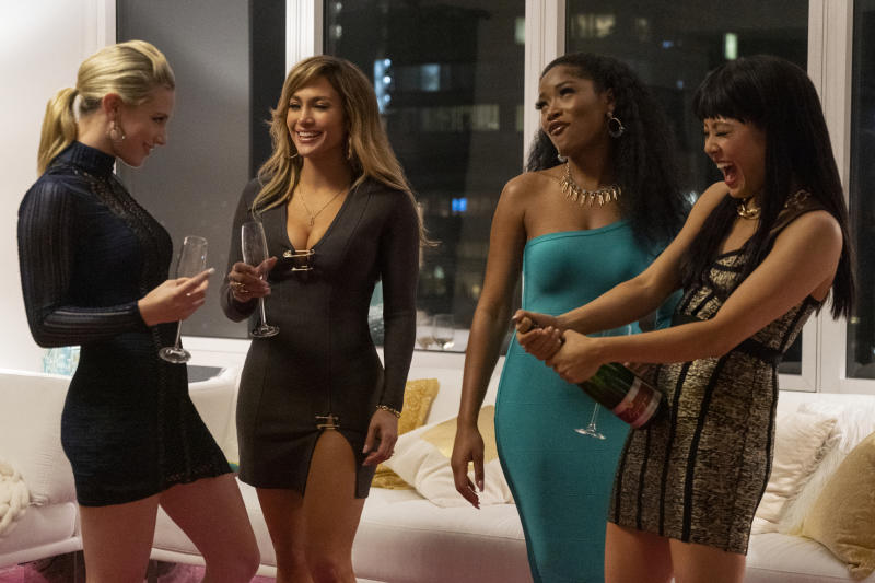 """This image released by STXfilms shows, from left, Lili Reinhart, Jennifer Lopez, Keke Palmer, and Constance Wu in a scene from """"Hustlers,"""" in theaters on Sept. 13. (Barbara Nitke/STXfilms via AP)"""