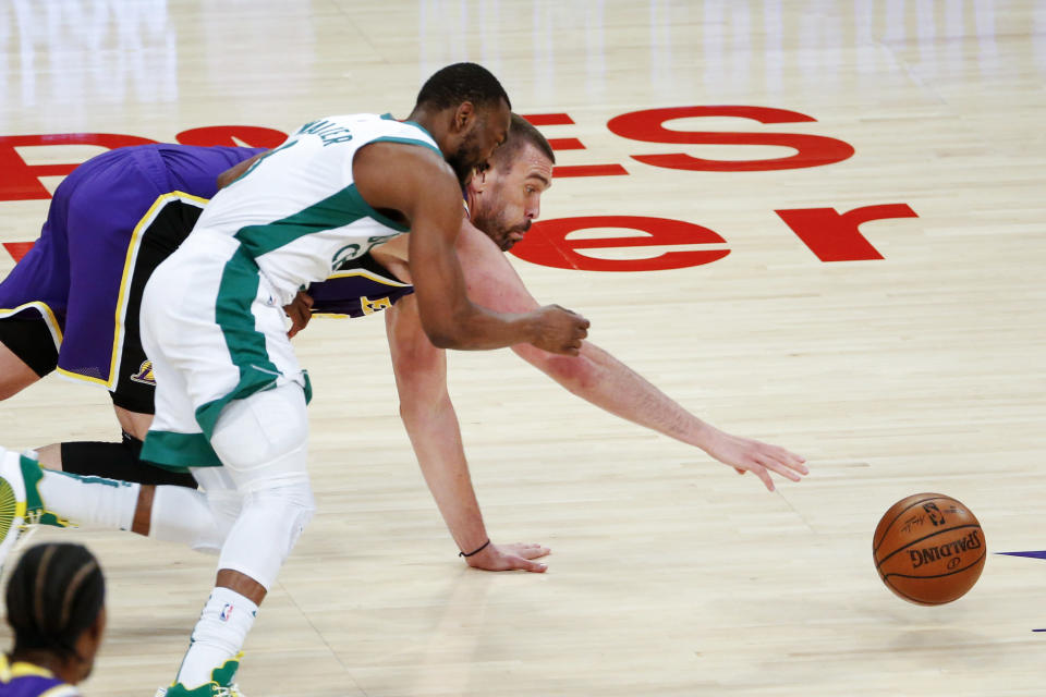 Los Angeles Lakers' Marc Gasol, back, and Boston Celtics' Kemba Walker chase the ball during the second half of an NBA basketball game Thursday, April 15, 2021, in Los Angeles. (AP Photo/Ringo H.W. Chiu)