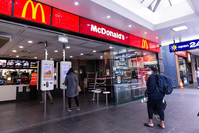 A popular McDonalds location across Flinders Street Station is seen empty during peak hour as the coronavirus continues to rapidly spread in Melbourne, Australia on March 23, 2020. From midday on March 23, 2020, venues such as bars, nightclubs, cinemas, restaurants and gyms and any other non-essentials are to close down until further notice from the government to help combat the spread of the virus. Australia currently has 2,136 cases of COVID-19. The death toll for Australia now stands at 8. (Photo by Mikko Robles/NurPhoto via Getty Images)