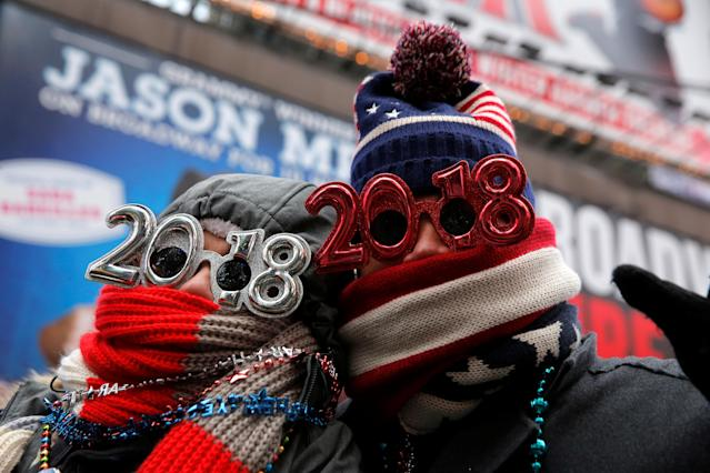 <p>Revelers gather in Times Square as a cold weather front hits the region ahead of New Year's celebrations in Manhattan, New York, December 31, 2017. (Photo: Andrew Kelly/Reuters) </p>