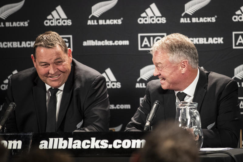 All Blacks head coach Steve Hansen, left, and selector Grant Fox react following the announcement of All Blacks squad for the Rugby World Cup at Eden Park, in Auckland, New Zealand, Wednesday, Aug. 28, 2019. Hansen has dropped 108-test veteran prop Owen Franks and gambled on the age and fitness of other players in naming a 31-man All Blacks which will attempt to win the Rugby World Cup for the third consecutive time. (Jason Oxenham/New Zealand Herald via AP)