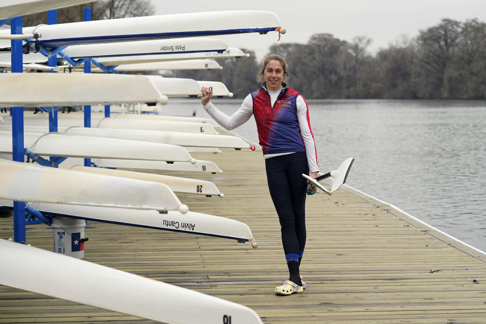 Rower Gevvie Stone poses for a photo at Lady Bird Lake ahead of the upcoming U.S. Olympic rowing trials, Friday, Feb. 12, 2021, in Austin, Texas. The silver medalist at the 2016 Rio de Janeiro Olympics came out of retirement and postponed her medical career as an emergency physician for one last chance at a gold medal. (AP Photo/Eric Gay)