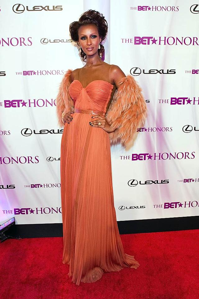 "But Iman bested both Kim and Kimora in the burnt orange, pleated J.Mendel gown she donned for the 4th annual BET Honors in Washington, D.C., where she was recognized for her philanthropic work. The 55-year-old supermodel capped off her stunning look with a desert ombre jacket. Paul Morigi/<a href=""http://www.wireimage.com"" target=""new"">WireImage.com</a> - January 15, 2011"