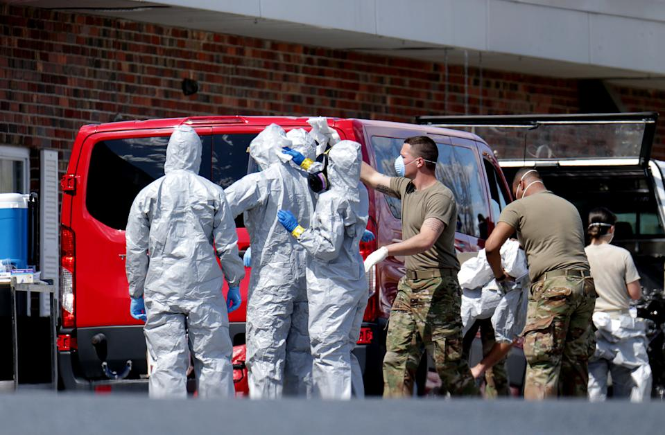 CHELMSFORD, MA - APRIL 7: Members of the Massachusetts National Guard put on hazmat suits as they are deployed to the Palm Center nursing home facility to aide in testing at the facility in Chelmsford, MA on Apr. 7, 2020. (Photo by Jonathan Wiggs/The Boston Globe via Getty Images)