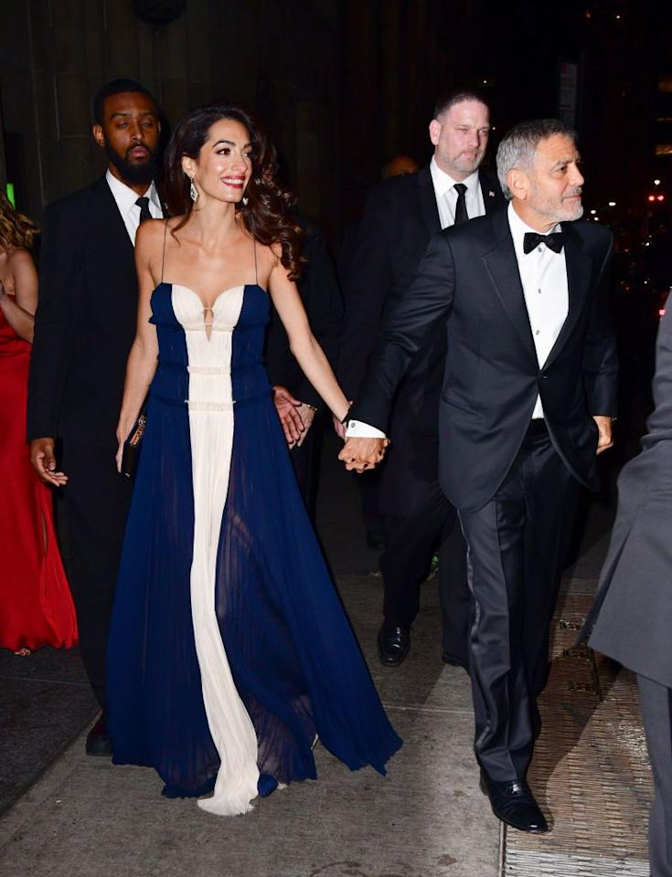 "<p>Amal wore a navy and white gown by J. Mendel to the United Nations Correspondents Associations Awards in New York City. The human rights lawyer complimented the dress's sweet-heart neckline with simple accessories of diamond statement earrings and a navy box clutch. </p><p><a rel=""nofollow"" href=""https://www.barneys.com/product/j.-mendel-colorblocked-silk-pliss-c3-a9-cocktail-gown-506062889.html"">SHOP SIMILAR </a> <em>Color-blocked Silk Plissé Cocktail Gown, J. Mendel, $4,490</em></p>"