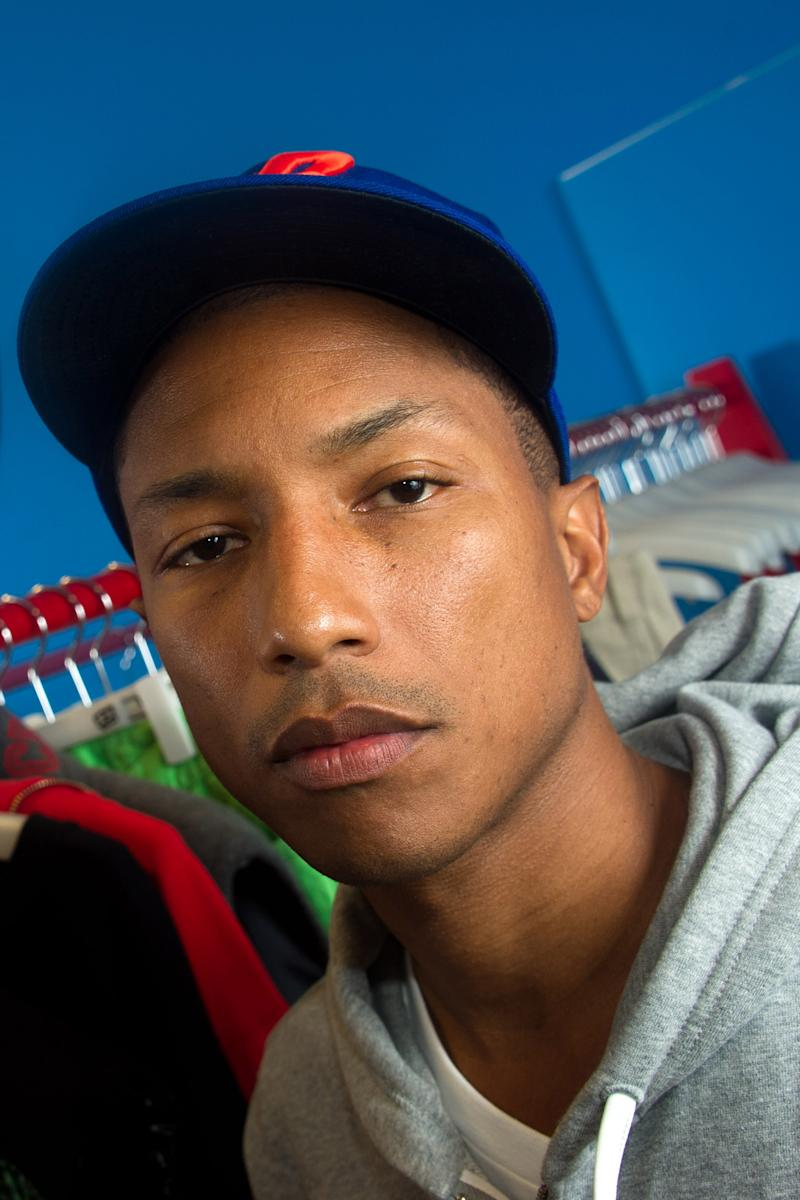FILE - Pharrell Williams poses for a portrait at his Billionaire Boys Club clothing line showroom in New York, in this April 21, 2011 file photo. The Academy Awards producers said Thursday Dec. 8, 2011 that Hans Zimmer and Pharrell Williams will serve as the show's music consultants. Neither musician has worked on the Oscars before.  (AP Photo/Charles Sykes, File)
