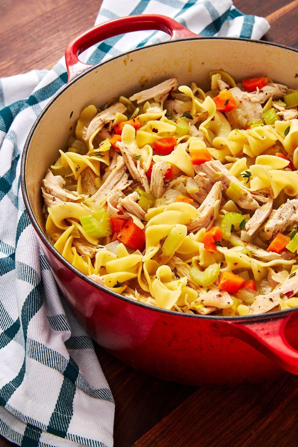 """<p>A warm (and easy!) way to use up leftover turkey.</p><p>Get the recipe from <a href=""""https://www.delish.com/cooking/recipe-ideas/a29089192/turkey-noodle-soup-recipe/"""" rel=""""nofollow noopener"""" target=""""_blank"""" data-ylk=""""slk:Delish"""" class=""""link rapid-noclick-resp"""">Delish</a>.</p>"""