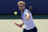 Peter Gojowczyk, of Germany, returns a shot to Henri Laaksonen, of Switzerland, during the third round of the US Open tennis championships, Friday, Sept. 3, 2021, in New York. (AP Photo/Seth Wenig)