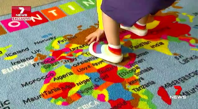 The toddler points out Kazakstan on a map. Source: 7 News