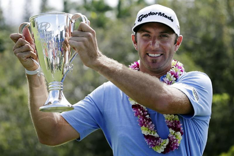 Dustin Johnson poses for photographers with the trophy after winning the Tournament of Champions PGA Tour golf tournament, Tuesday, Jan. 8, 2013, in Kapalua, Hawaii. Johnson closed with a 5-under 68 for a four-shot victory over Steve Stricker. (AP Photo/Elaine Thompson)