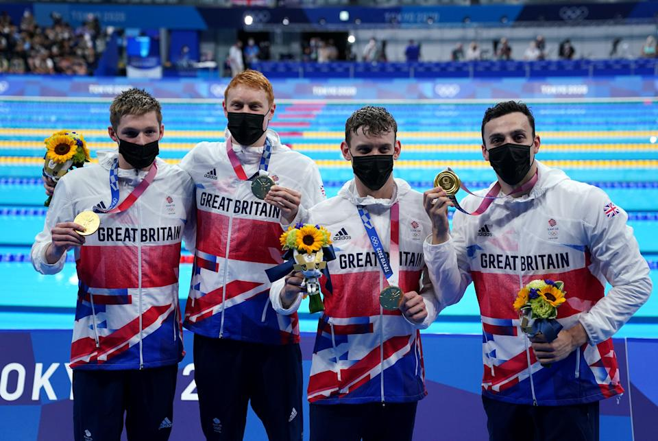 Great Britain's Duncan Scott, Tom Dean, Matthew Richards and James Guy celebrate gold in the Men's 4×200 freestyle relay (Adam Davy/PA) ( )