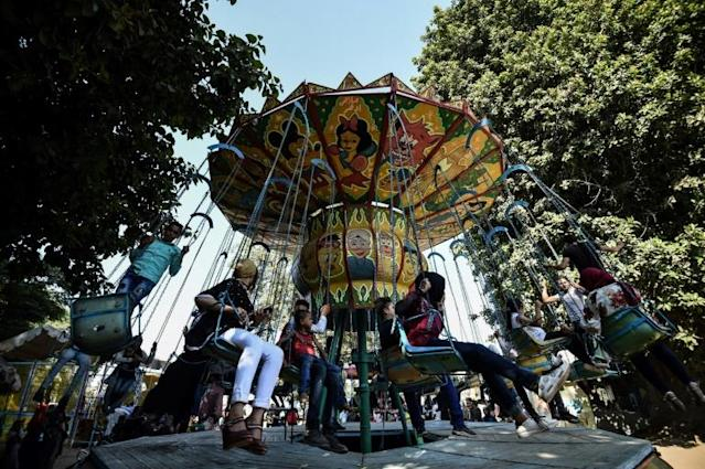 <p>Egyptians ride a merry-go-round at a park to celebrate the third day of Eid el-Adha in the city of Qanater Al-Khayria in the province of Qalioubia (AFP Photo/Mohamed el-Shahed) </p>