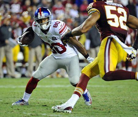 Sep 25, 2014; Landover, MD, USA; New York Giants wide receiver Victor Cruz (80) runs after a catch against the Washington Redskins during the second half at FedEx Field. Mandatory Credit: Brad Mills-USA TODAY Sports