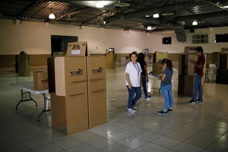 Electoral worker checks a polling station at the International Fairs and Convention Center in San Salvador, El Salvador, February 2, 2019. REUTERS/Jose Cabezas