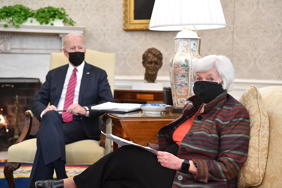 US Treasury Secretary Janet Yellen meets President Joe Biden in the Oval Office of the White House in Washington, DC, on January 29, 2021, for talks on the economy. (Photo by Nicholas Kamm / AFP) (Photo by NICHOLAS KAMM/AFP via Getty Images)