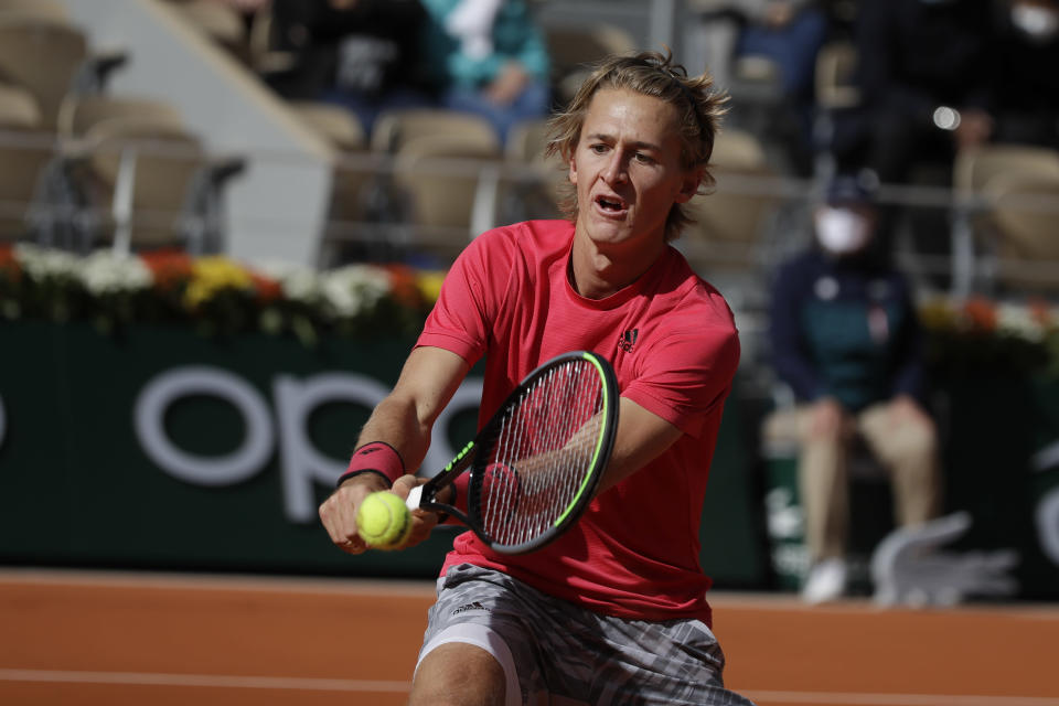 FILE - Sebastian Korda of the U.S. plays a shot against Spain's Rafael Nadal in the fourth round match of the French Open tennis tournament at Roland Garros stadium in Paris, France, in this Sunday, Oct. 4, 2020, file photo. Korda is the younger brother of Nelly Korda, who won the Women's PGA Championship to become the new No. 1 player in women's golf. (AP Photo/Alessandra Tarantino, File)