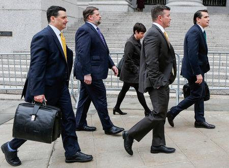 FILE PHOTO: Former Philidor Chief Executive Officer Davenport and ex-senior Valeant director Tanner walk on the street with their lawyers after exiting the Manhattan Federal Court in New York