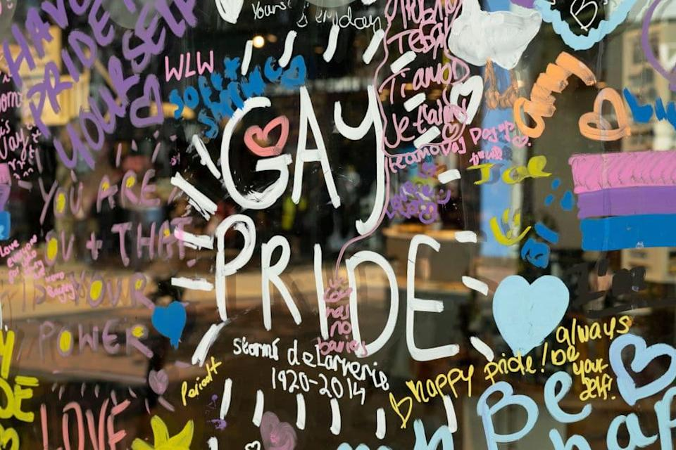 Shop window graffiti in support of the local gay and lesbian pride events on 14th June 2021 in Birmingham, United Kingdom.