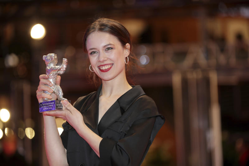 Actress Paula Beer holds The Silver Bear for Best Actress for the film 'Undine' after the award ceremony at the 70th International Berlinale Film Festival in Berlin, Germany. Saturday, Feb. 29, 2020. (AP Photo/Michael Sohn)