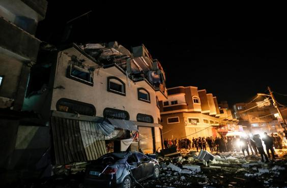 Palestinians inspect the damaged house of Islamic Jihad leader Baha Abu al-Ata afther an Israeli attack in Gaza city (AFP/Getty)