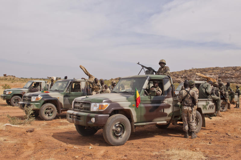 "In this Nov. 24, 2012 photo, soldiers from a Malian army special unit stand atop pick-ups mounted with machine guns, following a training exercise in the Barbe military zone, in Mopti, Mali. Secretary-General Ban Ki-moon said Friday, Jan. 11, 2013, that France, Senegal and Nigeria have responded to an appeal from Mali's President Dioncounda Traore for help to counter an offensive by al-Qaida-linked militants who control the northern half of the country and are heading south. The U.N. chief said that assisting the Malian defense forces push back against the Islamist armed groups is ""very important.""(AP Photo/Francois Rihouay)"