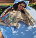 Athiya Shetty posted a picture of her enjoying her book <strong>Palace of Illusions by Chitra Banerjee Divakaruni.</strong>