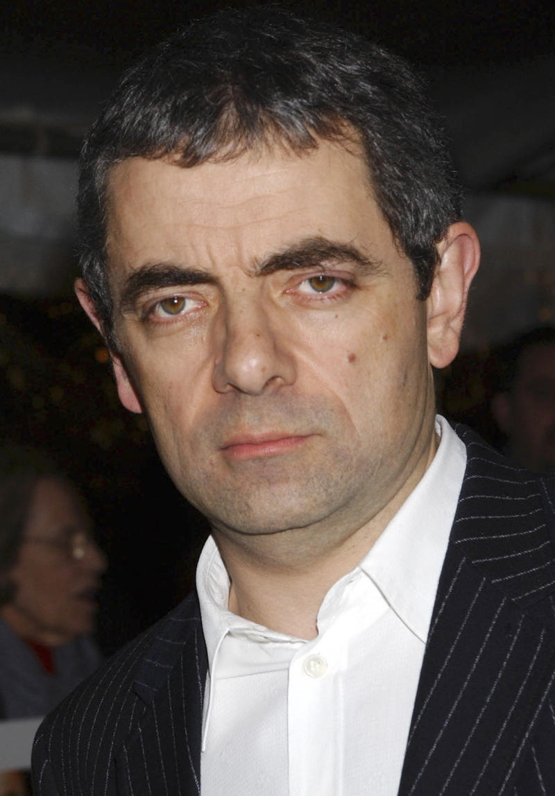 """FILE -- British actor and comedian Rowan Atkinson, seen in this Thursday Nov. 6, 2003 file photo, is recovering in hospital in Peterborough, England, Friday Aug. 5, 2011, after crashing his sports car.  Atkinson, famed for his hapless driving in the """"Mr. Bean"""" television shows and films, was involved in a road accident late Thursday, but did not disclose details of his minor injuries. Atkinson was driving his McLaren F1 supercar - one of the world's fastest road cars -  when he crashed, striking a tree and a lamppost before the vehicle caught fire, authorities said.(AP Photo/Jennifer Graylock, file)"""