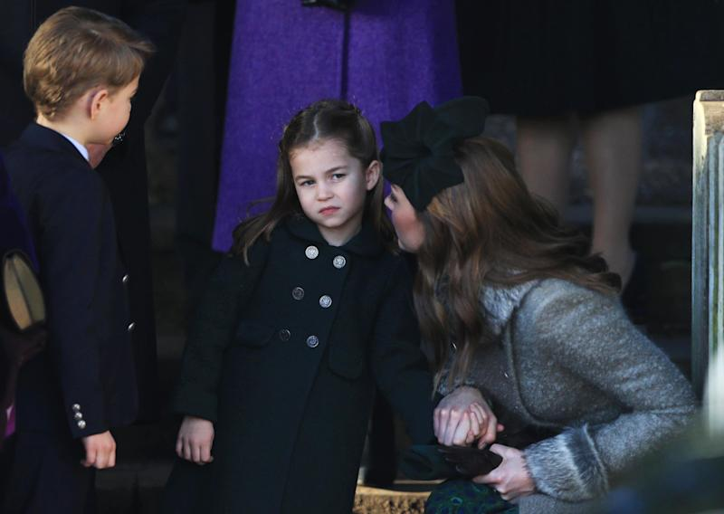 Catherine, Duchess of Cambridge speaks to Princess Charlotte as Prince George watches as they leave after attending the Christmas Day Church service at Church of St Mary Magdalene on the Sandringham estate on December 25, 2019 in King's Lynn, United Kingdom.