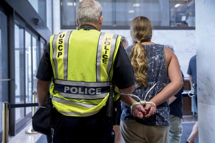 <p>Capitol Hill police officers arrest a group protesting the Republican healthcare bill outside the offices of Sen. Lisa Murkowski, R-Alaska, on Capitol Hill in Washington, Monday, July 17, 2017. (Photo: Andrew Harnik/AP) </p>