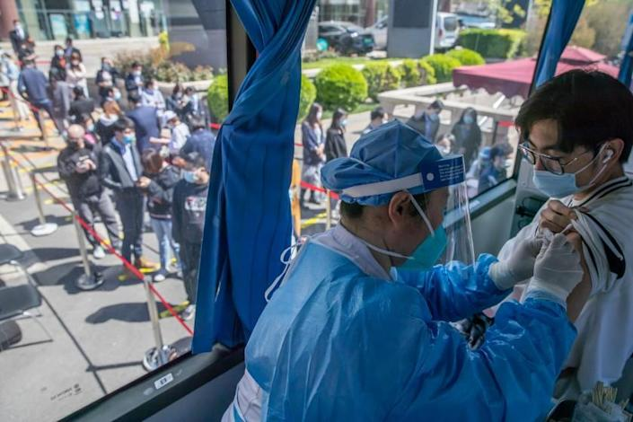 The man was vaccinated with the COVID-19 vaccine in a mobile COVID-19 vaccination vehicle in Beijing, China, on April 13, 2021.