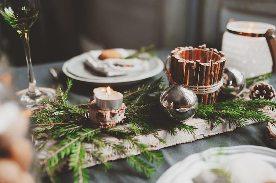 branches on table with plates, fall decorating tips