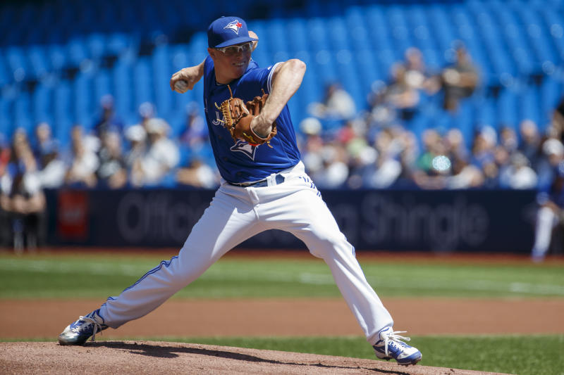 TORONTO, ON - AUGUST 11: Trent Thornton #57 of the Toronto Blue Jays pitches during the first inning of MLB action against the New York Yankees at Rogers Centre on August 11, 2019 in Toronto, Canada. (Photo by Cole Burston/Getty Images)