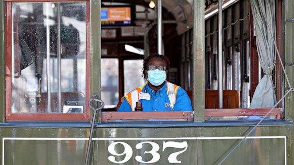 PHOTO: A streetcar driver wears a mask amid the coronavirus outbreak, in New Orleans, March 25, 2020.  (Jonathan Bachman/Reuters)