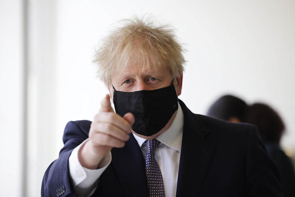 Britain's Prime Minister Boris Johnson, wearing a face covering due to Covid-19, gestures as he takes part in a science lesson at King Solomon Academy in London, on April 29, 2021. (Photo by Dan Kitwood / POOL / AFP) (Photo by DAN KITWOOD/POOL/AFP via Getty Images)