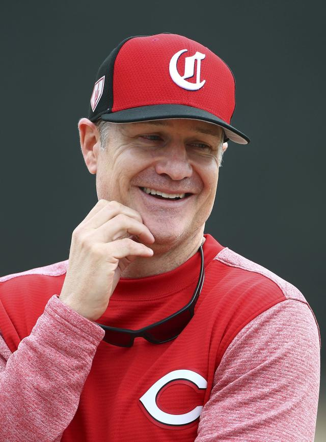 Cincinnati Reds manager David Bell talks with a staff member during workouts at the Reds spring training baseball facility, Wednesday, Feb. 13, 2019, in Goodyear, Ariz. (AP Photo/Ross D. Franklin)