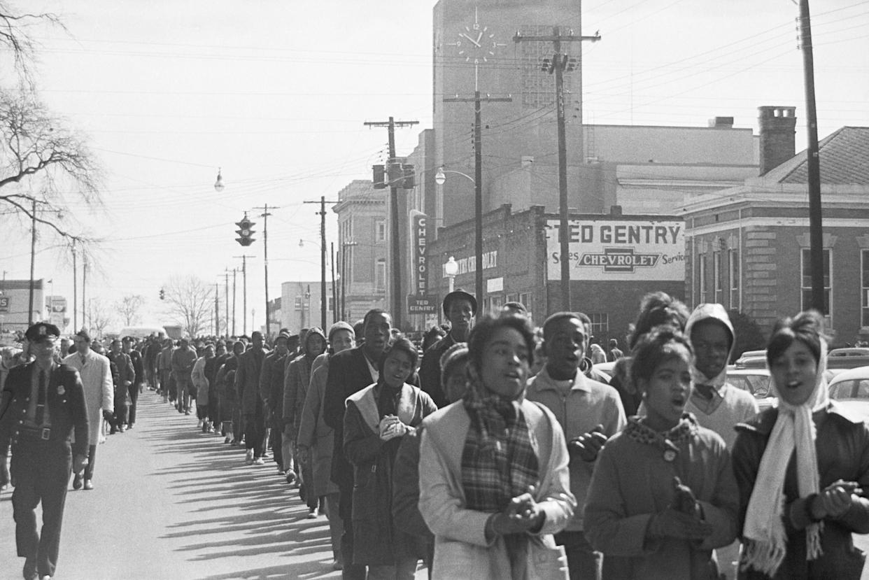 Alabama State troopers 'frisk' Negro youths arrested during demonstrations here prior to boarding them on buses. More than 130 were arrested in Marion, AL on Feb. 5, 1965.