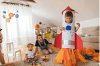<p>Roll a giant piece of posterboard into a circle (with a hole cut out for his face) and secure with tape. Add fins and a rocket top, plus tissue paper flames and he'll be ready for blast off!</p>