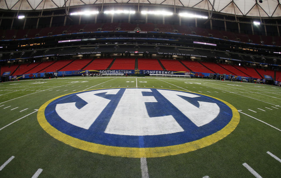 FILE - In this Dec. 5, 2014, file photo, SEC logo is displayed on the field ahead of the Southeastern Conference championship football game between Alabama and Missouri in Atlanta. The Southeastern Conference distributed an average of $40.9 million to its member schools in the last fiscal year. Commissioner Greg Sankey said Thursday, Feb. 1, 2018, the league divvied $573.8 million in revenue among its 14 members for the fiscal year which ended August 31, 2017. Football bowl teams also kept $23.1 million to cover travel and other expenses. (AP Photo/John Bazemore, File)