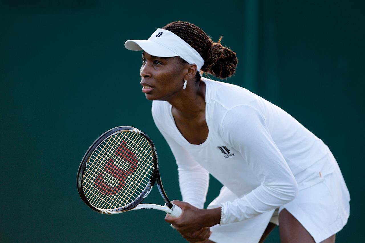 LONDON, ENGLAND - JUNE 30:  Venus Williams of the USA in action while playing with Serena Williams of the USA during their Ladies' Doubles second round match against Maria Kirilenko and Nadia Petrova of Russia on day six of the Wimbledon Lawn Tennis Championships at the All England Lawn Tennis and Croquet Club at Wimbledon on June 30, 2012 in London, England.  (Photo by Paul Gilham/Getty Images)