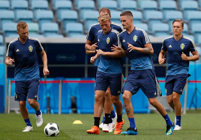 Sweden national soccer team players vie for a loose ball as they jog during a training session on the eve of their Group F match against Germany, during the 2018 soccer World Cup in Sochi, Russia, Friday, June 22, 2018. (AP Photo/Rebecca Blackwell)
