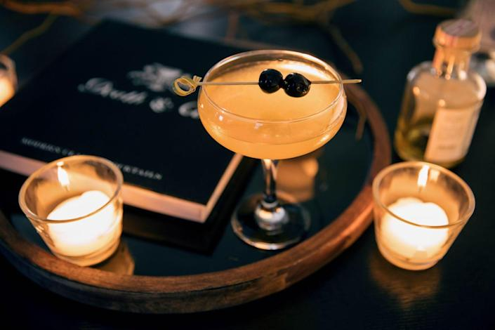 """<p><strong>Ingredients</strong></p><p>4 oz gin<br>2 oz Grand Marnier<br>1 lemon<br>2 oz simple syrup<br>2 oz sauvignon blanc<br>Splash of absinthe<br>4 maraschino cherries</p><p><strong>Instructions</strong></p><p>Combine gin, Grand Marnier, absinthe, sauvignon blanc, and simple syrup in a large shaker, then add juice of one lemon. Add ice and shake for at least 30 seconds before pouring into coupe glasses. Garnish with two maraschino cherries skewered on bamboo cocktail sticks.</p><p><em>From <a href=""""https://www.thumbtack.com/"""" rel=""""nofollow noopener"""" target=""""_blank"""" data-ylk=""""slk:Thumbtack"""" class=""""link rapid-noclick-resp"""">Thumbtack</a> Chef and Owner of Let's Eat Sonoma, <a href=""""https://www.thumbtack.com/-Santa-Rosa-CA/service/2226141"""" rel=""""nofollow noopener"""" target=""""_blank"""" data-ylk=""""slk:Michelle Fitzgerald"""" class=""""link rapid-noclick-resp"""">Michelle Fitzgerald</a></em></p><p><a class=""""link rapid-noclick-resp"""" href=""""https://go.redirectingat.com?id=74968X1596630&url=https%3A%2F%2Fdrizly.com%2Fgrand-marnier-cordon-rouge%2Fp3580&sref=https%3A%2F%2Fwww.townandcountrymag.com%2Fleisure%2Fdrinks%2Fg2839%2Fhalloween-drinks%2F"""" rel=""""nofollow noopener"""" target=""""_blank"""" data-ylk=""""slk:Buy Now"""">Buy Now</a> <em>Grand Marnier, from $24.99</em><br></p>"""