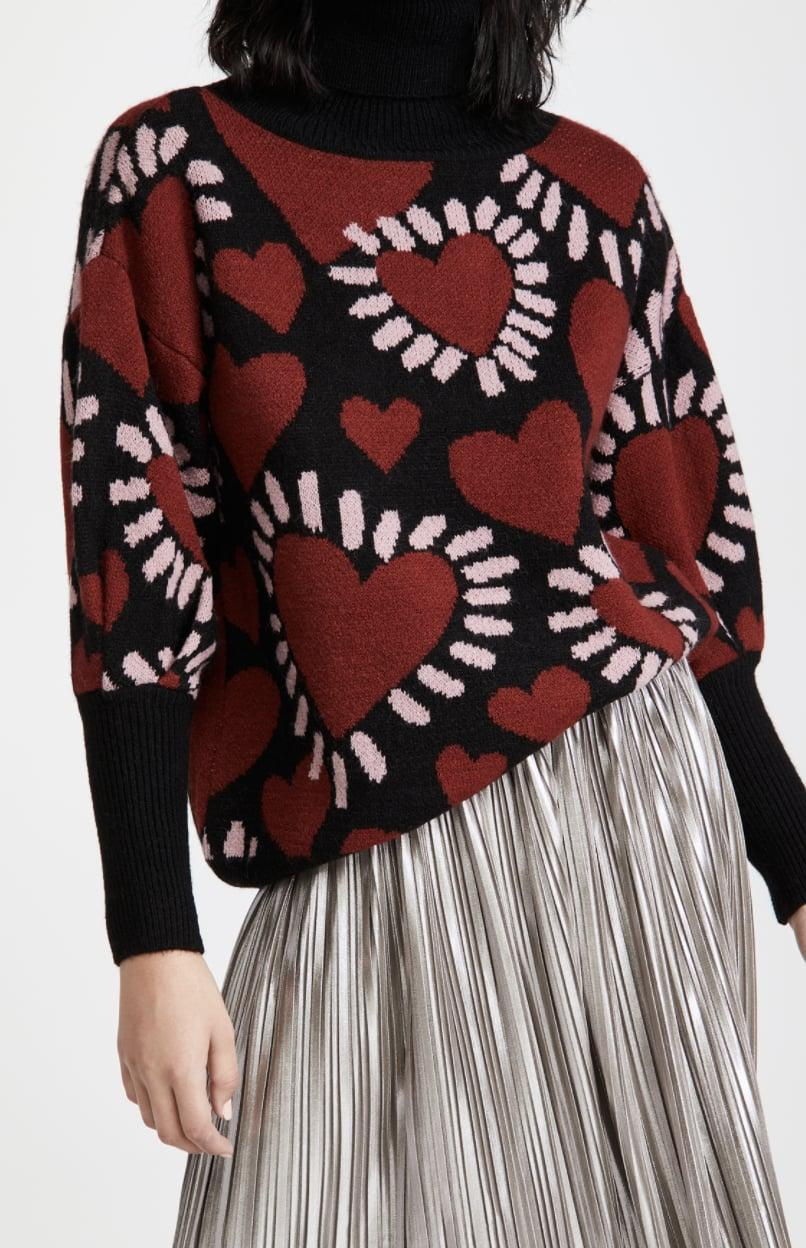 <p>Just in time for Valentine's Day, grab this <span>FARM Rio Hearts Sweater </span> ($155).</p>