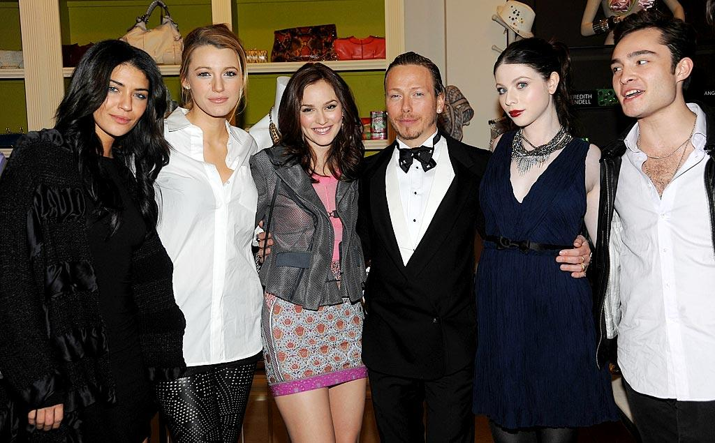 """(From left to right) Jessica Szohr, Blake Lively, Leighton Meester, """"Gossip Girl"""" costume designer Eric Daman, Michelle Trachtenberg, and Ed Westwick toasted the release of Daman's new book of fashion advice, """"You Know You Want It,"""" at Henri Bendel in NYC. Jamie McCarthy/<a href=""""http://www.wireimage.com"""" target=""""new"""">WireImage.com</a> - January 12, 2010"""