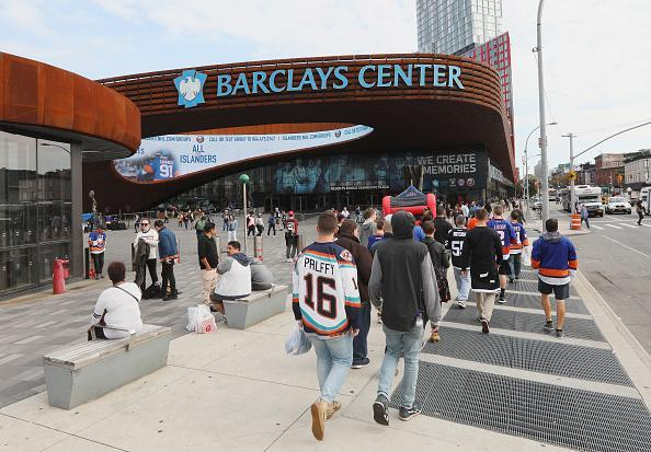 """Fans arrive for the season opening game between the <a class=""""link rapid-noclick-resp"""" href=""""/nhl/teams/nyi/"""" data-ylk=""""slk:New York Islanders"""">New York Islanders</a> and the <a class=""""link rapid-noclick-resp"""" href=""""/nhl/teams/ana/"""" data-ylk=""""slk:Anaheim Ducks"""">Anaheim Ducks</a> at the Barclays Center on October 16, 2016 in the Brooklyn borough of New York City. (Photo by Bruce Bennett/Getty Images)"""