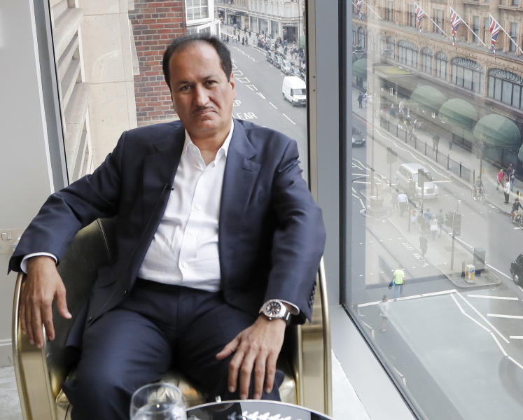FILE - In this Aug. 21, 2017 file photo, DAMAC Properties chairman Hussain Sajwani speaks during an interview with The Associated Press in London. DAMAC Properties, Dubai's largest, fully private real estate developer, on Sunday, March 29, 2020, posted its first yearly loss since becoming a publicly traded company in 2013, a worrying sign for the sheikhdom's already-reeling vital property market now struggling with the new coronavirus pandemic. (AP Photo/Frank Augstein, File)